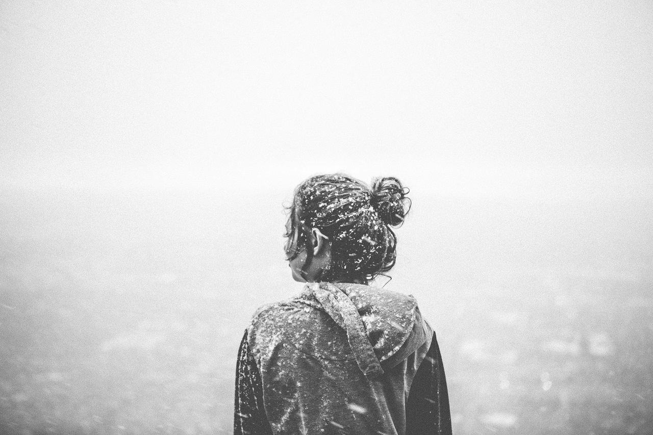 a girl covered by snow